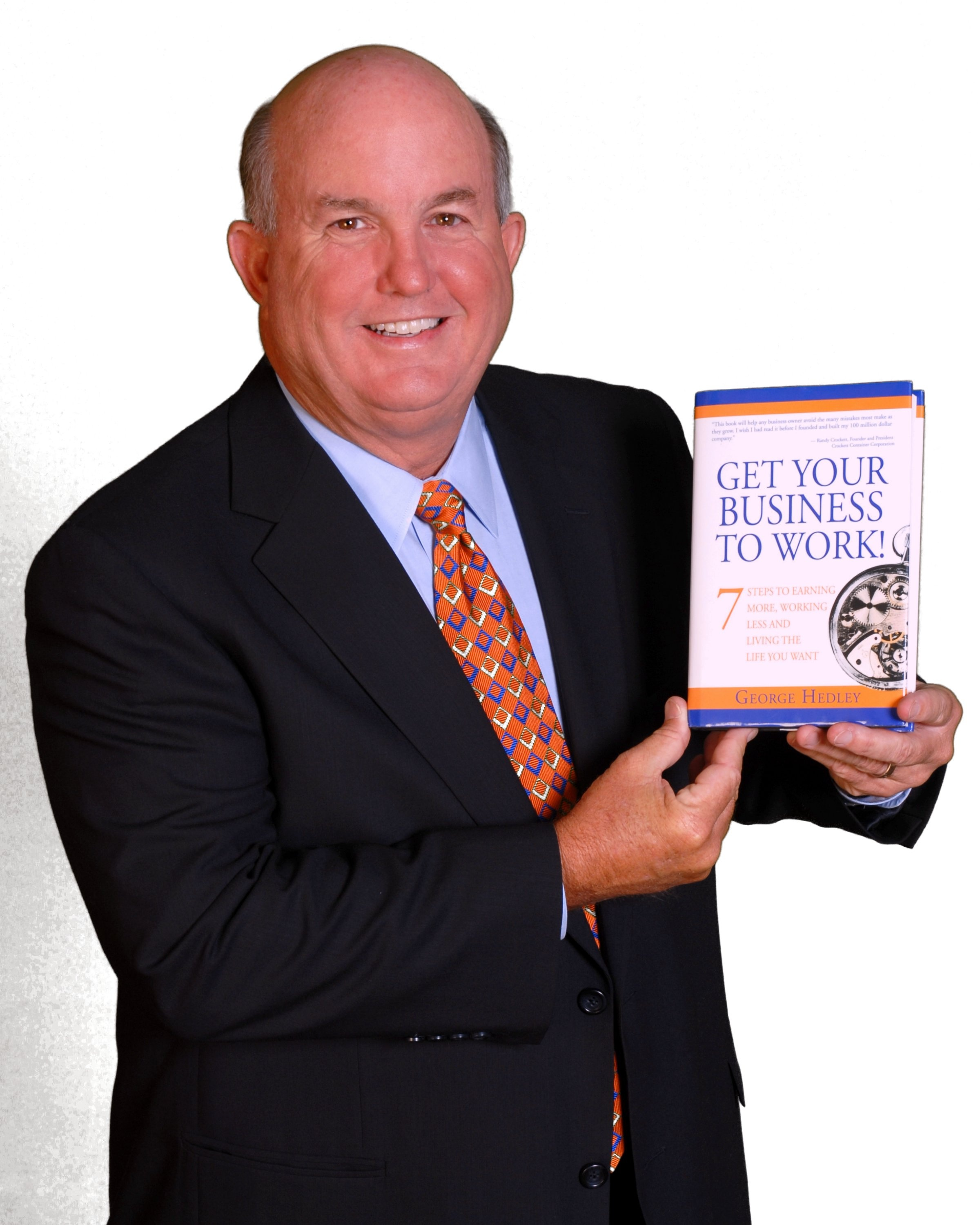 George Hedley Photo with his bestselling Book