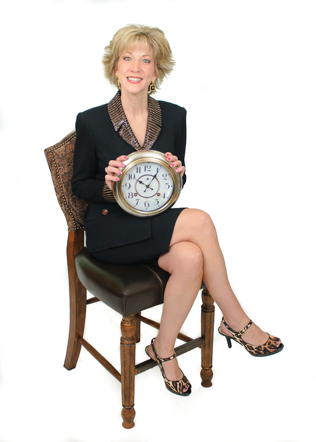 Laura Stack Black 20 sitting with clock