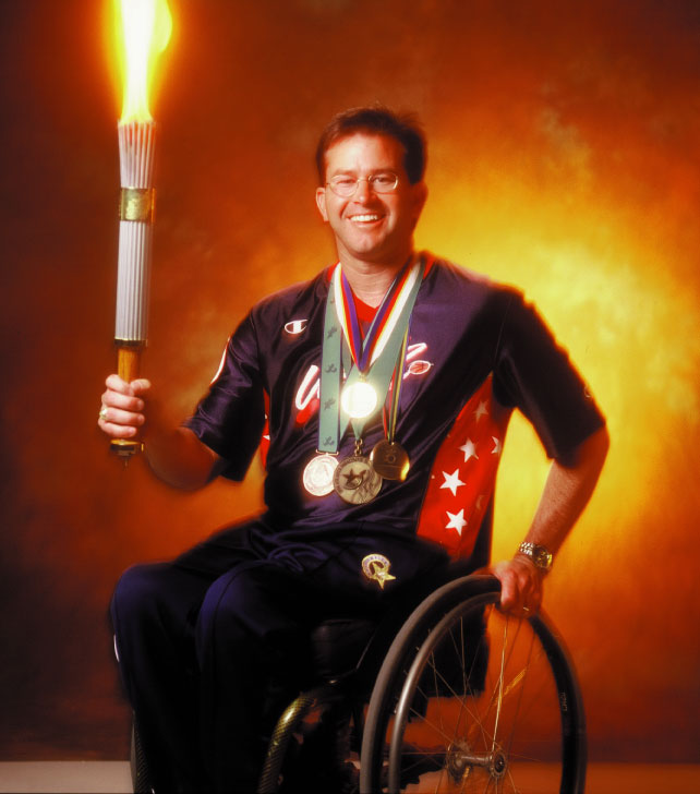 Mike with Medals and Olympic Torch